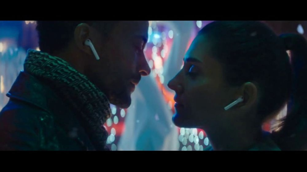 Lauren Yalango Grant and Christoper Grant in apple sway holiday commercial